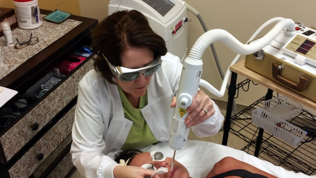 Linda Murray using laser technology.